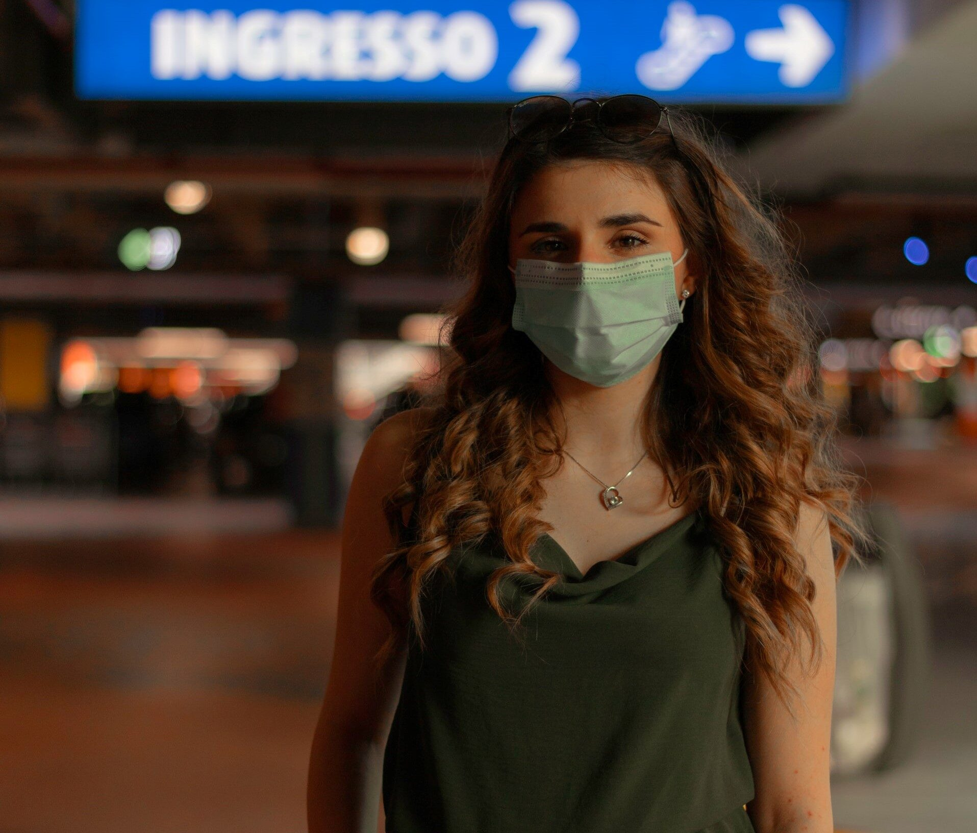 young healthy woman wearing surgical mask